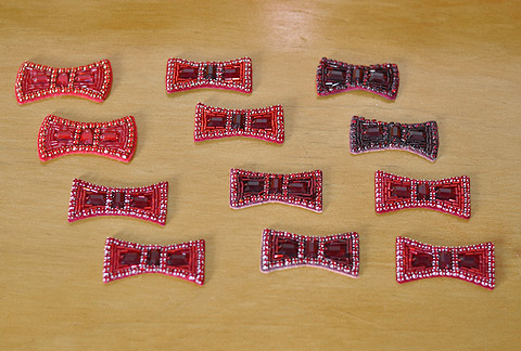 Hand-sewn bows for Judy Garland's ruby slippers